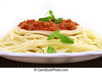 Freshly cooked plate of spaghetti with fresh green herbs