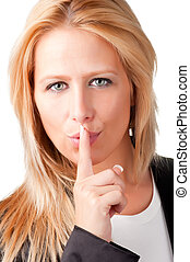 Secret - Business woman with her finger over her mouth,...