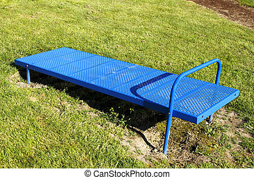 Incline Sit Up Bench - Blue metal sit-up bench with a sloped...