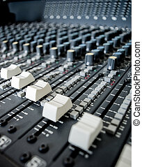 Audio Engineer Mixing Board - Close up of audio mixing board...