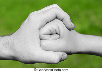 hand stops fist - black and white hand holding or stopping a...