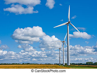 Wind turbines on field