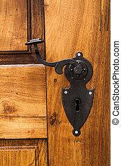 old wood door with metal handle