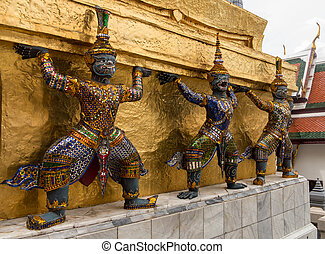 Grand Palace in Bangkok Thailand with dancing demons holding...