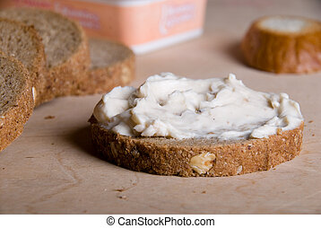 Slice of bread with cheese cream - Piece of bread with a...