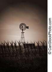 Windmills in the field in a spring night