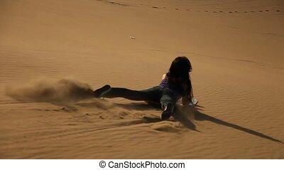 sandboarding in dunes - video footage of sandboarding in...