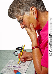 pensioner with sudoku