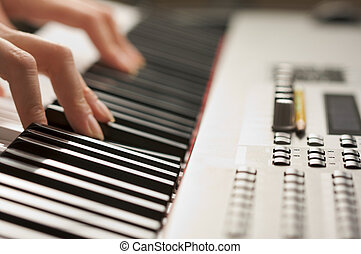 Womans Fingers on Piano - Womans Fingers on Digital Piano...