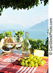 Wine and grapes against Geneva lake. Lavaux region,...