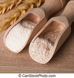 Meal and flour in the wooden spoon closeup