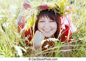 Young Woman Laying on Grass Portrait