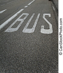Bus lane sign road marking - Bus stop sign painted on public...