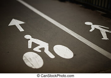 Bikes and pedestrian lanes - White painted sign for bikes...