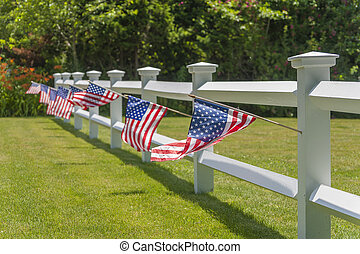White fench with American flags - Patriotic picket white...
