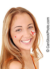 Happy teen girl wearing canada day stickers