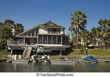 Executive house on the water with seaplane - Executive home...