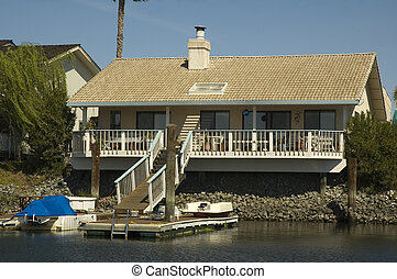 smaller house on the water - smaller home in a housing...