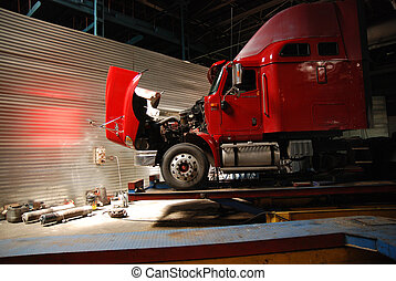 Red open truck in big service garage