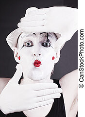funny mime - Portrait of a funny mime in white hat on a...