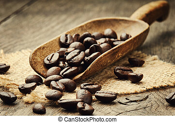 Coffee beans in scoop