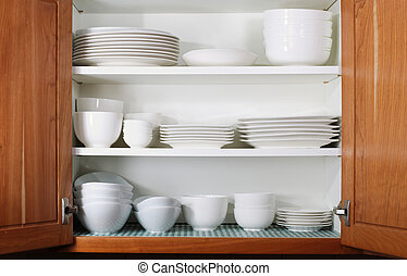 New White Dishes and Bowls in Kitchen Cabinet - Whites...