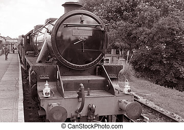 Steam Train on Platform in Black and White Sepia Tone