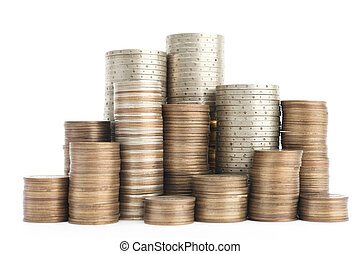 Mixture of gold, bronze and silver coins stands vertically in columns