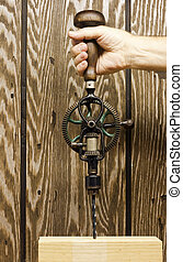 antique hand drill - using a retro hand drill to bore a hole...