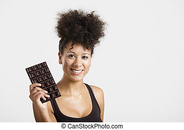 Woman with a chocolate bar