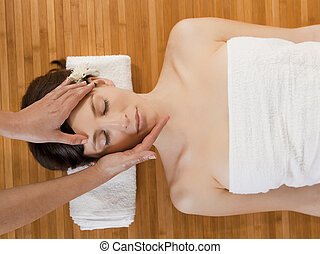 Face massage - Beautiful and attractive woman on a spa...