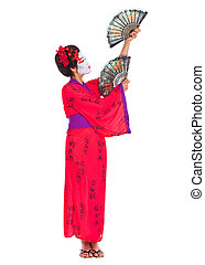 Full length portrait of geisha dancing with fans isolated on...