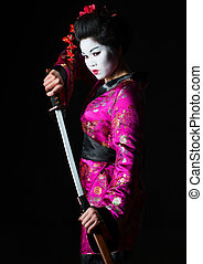 Portrait of geisha warrior pulls out sword of sheath on...