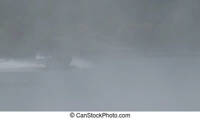 Jet boat in thermal steam - Taupo - Early morning mist of...