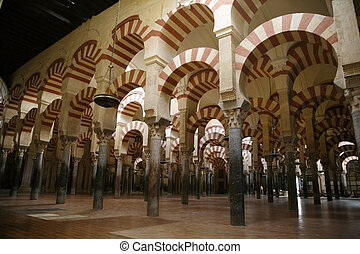 cordoba mosque archs - interior archs in the cordobas mosque...