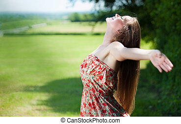 Hello Sun! - young cute woman enjoys the sun and nature...