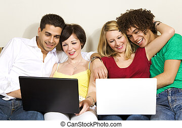 domestic life: two couples using laptops