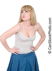 Beautiful blonde looks upward, hands on a belt