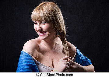 Portrait of beautiful blonde braiding a plait- isolated on...