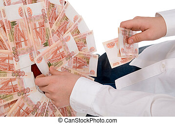 Person in a white shirt gathers money in a hand.Isolated on...