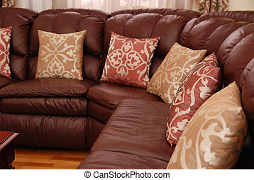 pillows on a leather sofa - pillows on a brown leather sofa