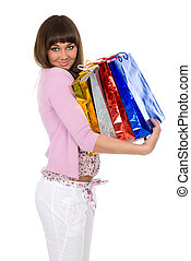 beautiful brunette with packages on hands