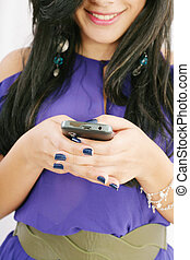 Clouse up of unrecognizable young woman text messaging