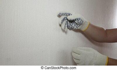 Man in glove showing