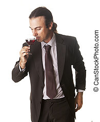 sommelier - a sommelier tasting a glass of wine