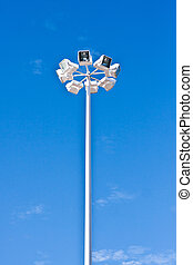 Floodlight - Tall modern floodlights agains a bright blue...