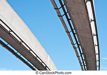 Monorail - Pair of monorail lines against a blue sky