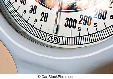 Weighing scales - Close up of the dial of a retro set of...