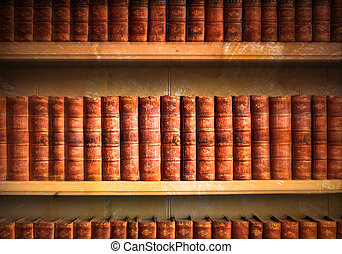 Old library - Collection of old weathered books in vintage...