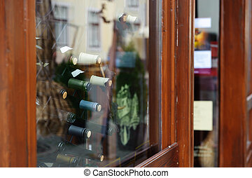 Shopfront of winery - Glass showcase of wine shop n small...